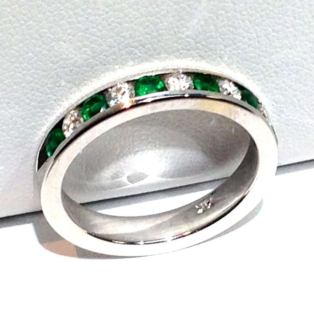 14k white gold channel set emerald and ring